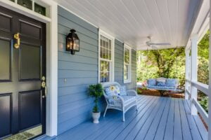 Front porch of house, chair and swig, no people